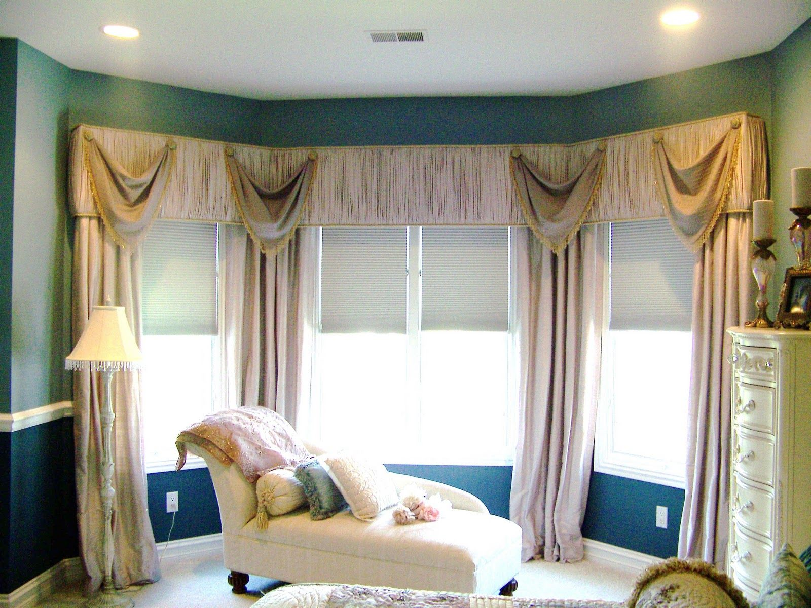 Comfortable Bedroom Decorated With Long Curtain On Bay ...