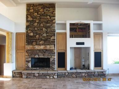 Do it yourself sw fireplace mantel uses a pine character log for the do it yourself sw fireplace mantel uses a pine character log for the mantle river rock covers the fireplace and hearth sandstone caps the hearth and a solutioingenieria Choice Image