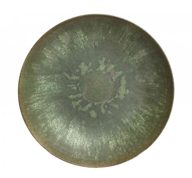 An Otto and Gertrude Natzler Pottery Bowl, Diameter 11 of low form, with a green glaze, marked Natzler.