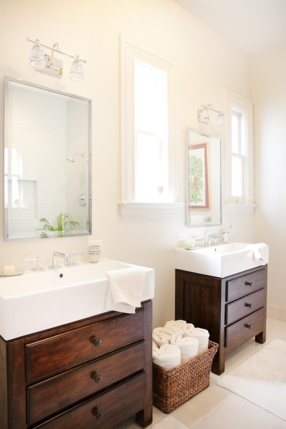 The updated master bathroom features his and her vanities with ...