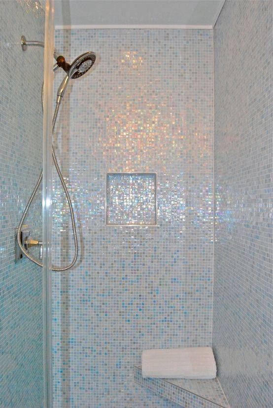 This Bathroom Features Iridescent Glass Mosaic Tiles From Floor To Ceiling The Mosaics Also Cover The Floati With Images Mosaic Shower Tile Shower Tile Glass Tile Shower