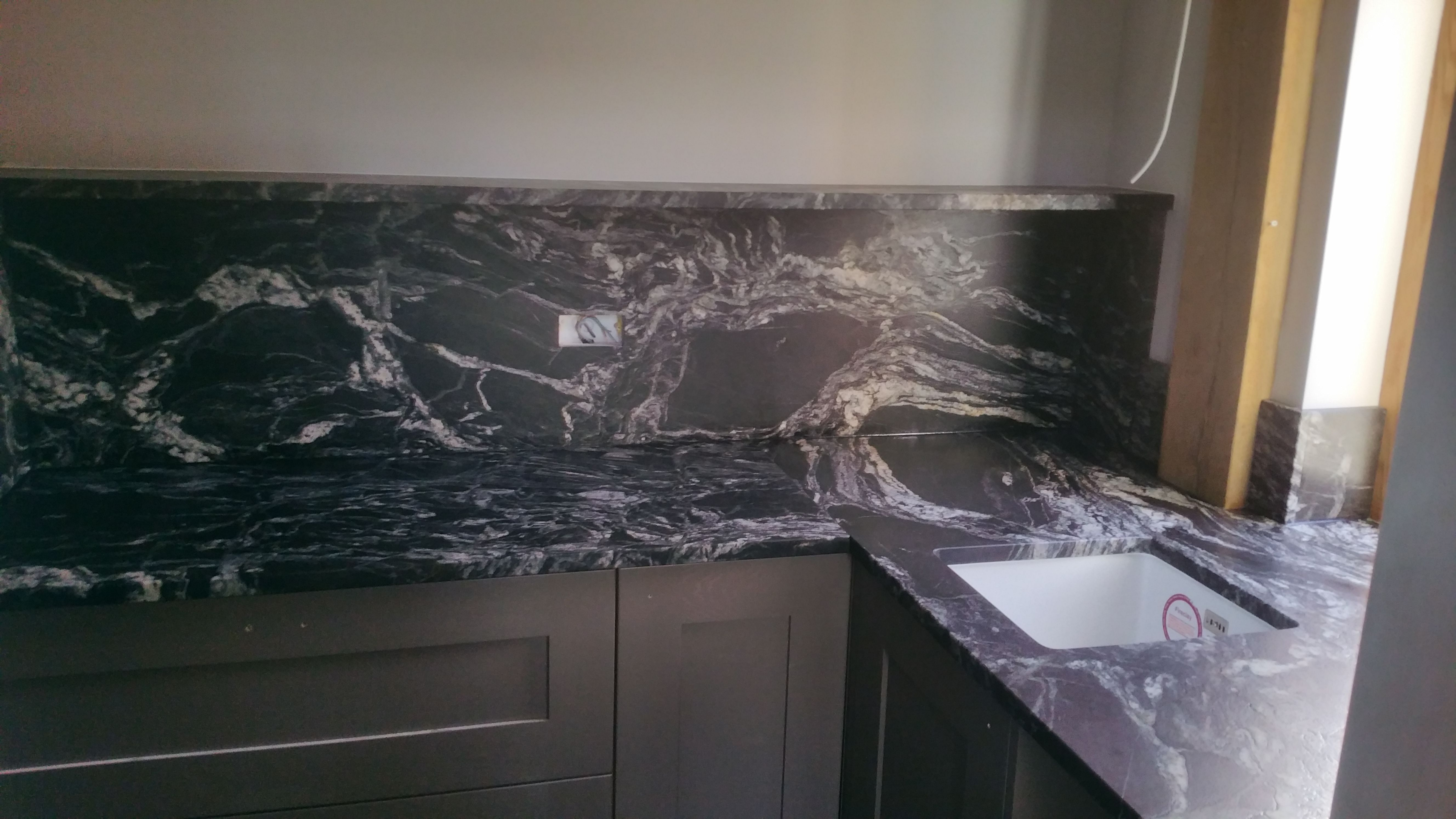 Leathered Cosmic Black Granite Kitchen