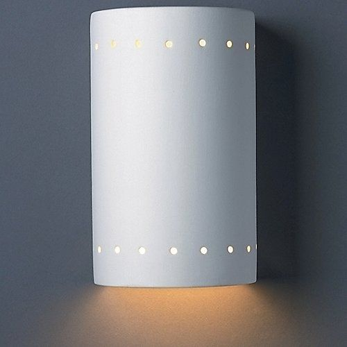 A simple sconce with endless possibilities. The Justice Design Cylinder Wall Sconce features a cylindrical White ceramic shade. It comes in a variety of sizes, with or without a decorative band of perforations and with or without uplight. From there, the Paintable Bisque surface allows you to paint and customize the sconce with any color.