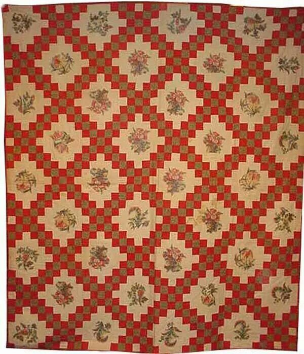 Irish chain quilt with broderie perse in background spaces shown by Laura Fisher