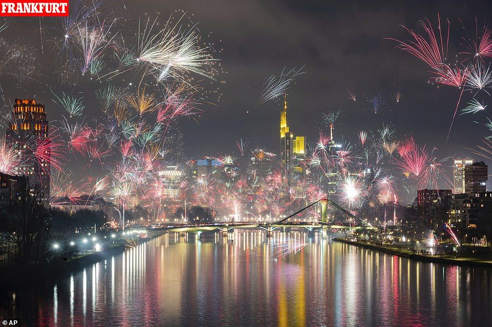 Millions across US ring in the new year as ball drops in
