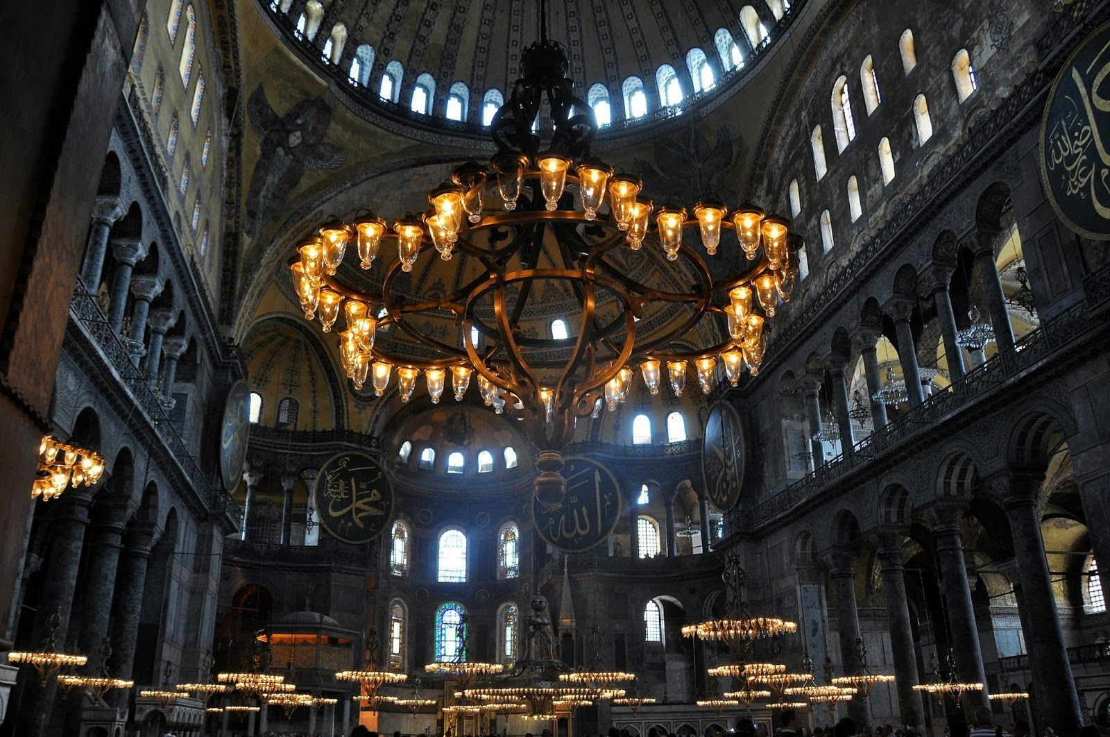 The must see places in istanbul turkey chandeliers istanbul chandeliers under the great dome of the hagia sophia in istanbul aloadofball Images