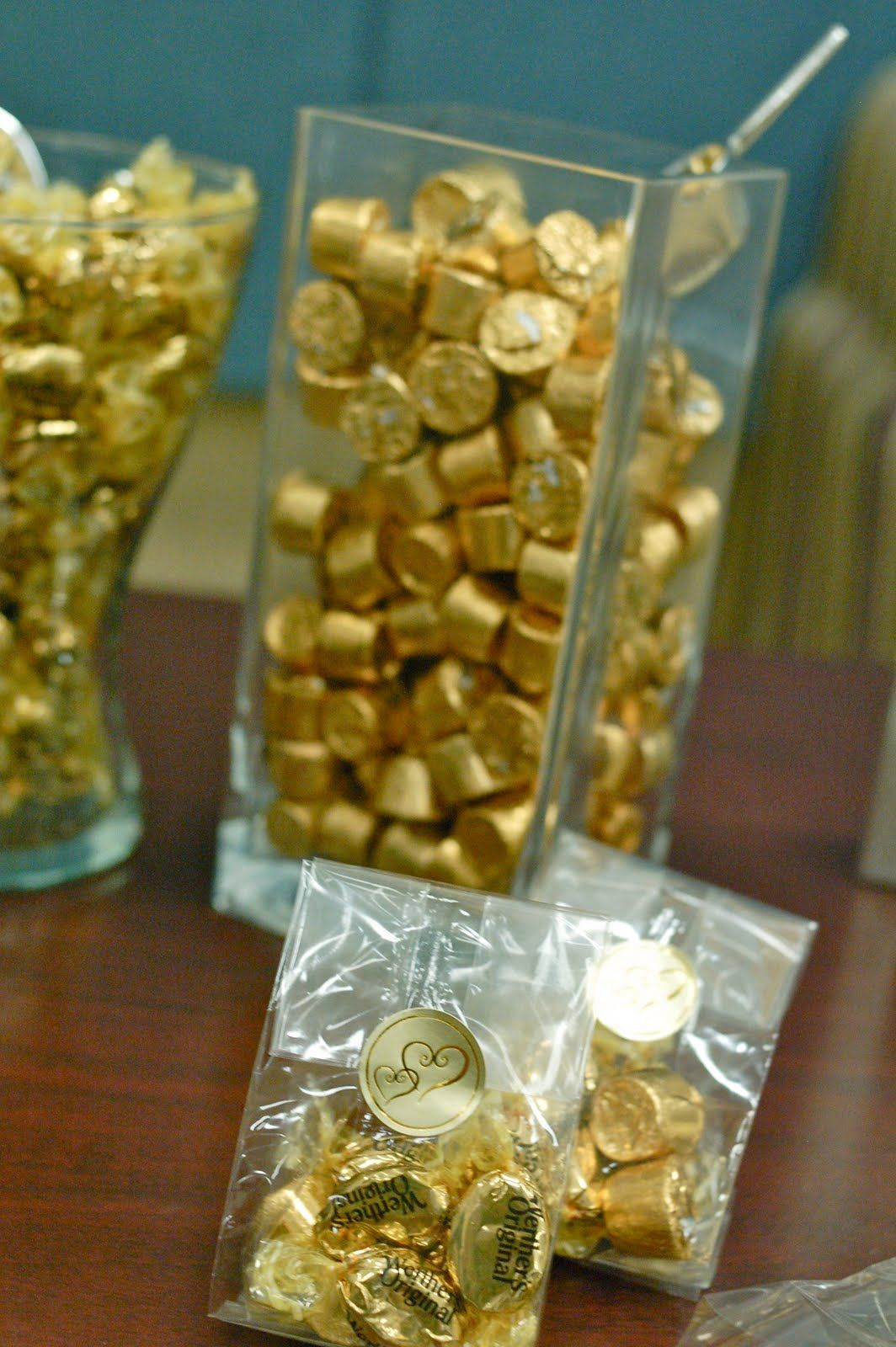 Decoration ideas for 50th wedding anniversary celebration  Rolos Werthers Hershey Nuggets Kisses with almonds  Golden