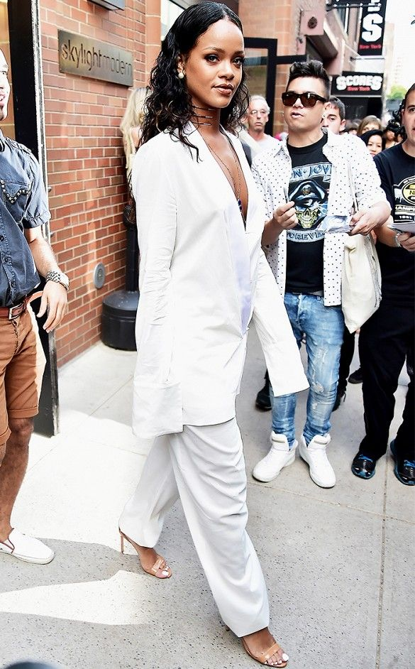 d0af03d0d6b4 Rihanna hints femininity in an oversized mens-inspired suit with a deep-v  plunge neckline.     Celebrity  white