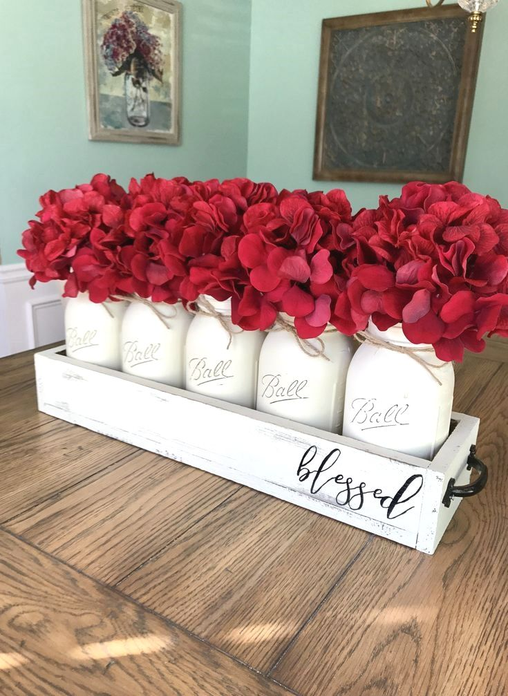 Looking to add a pop of color to your space? This mason jar centerpiece will do the trick! It has subtle and beautiful cream jars, distressed cream box, and gorgeous deep red hydrangeas. CODE… #masonjardiy