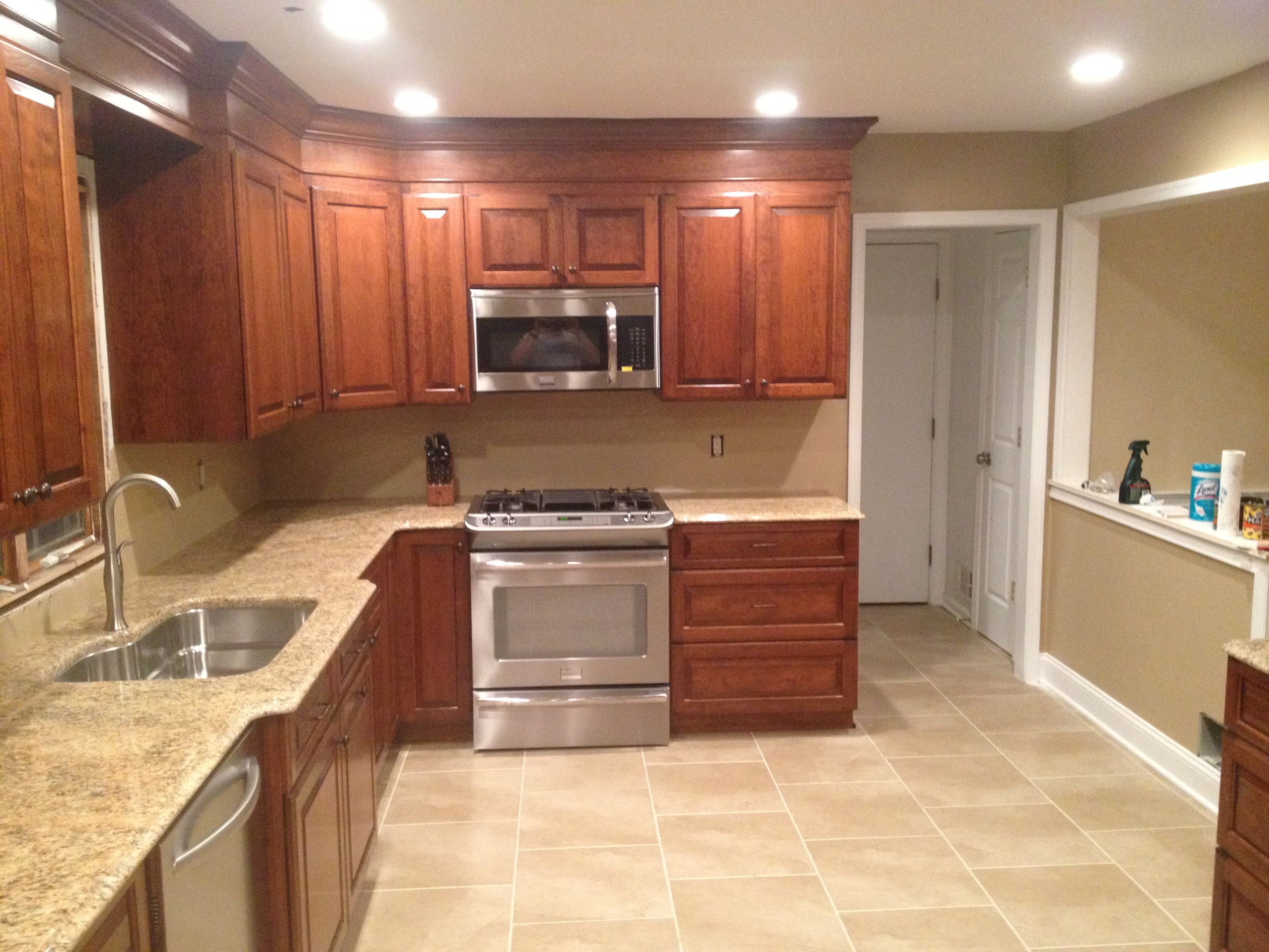 Dark cabinets and light countertops.. Amish made kitchen ...
