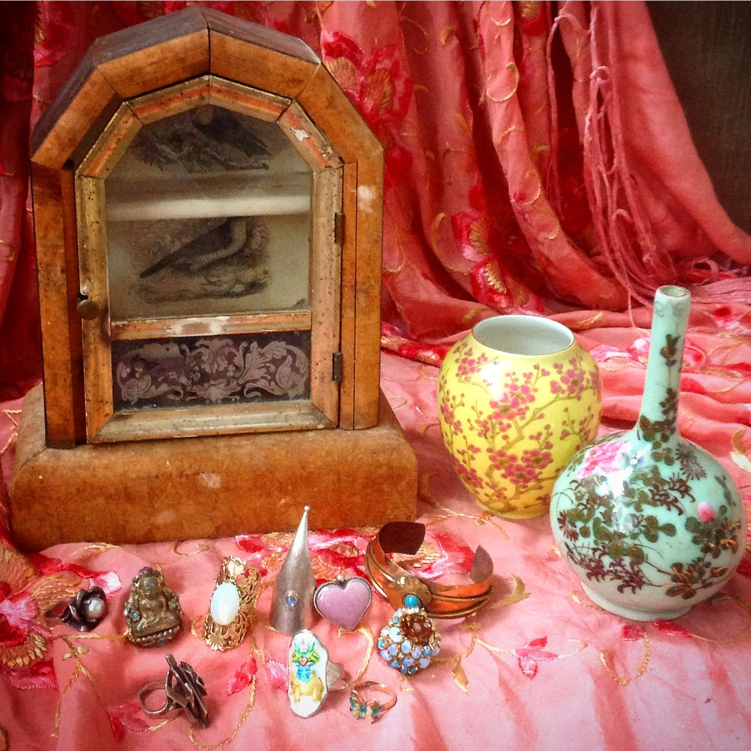 sweet mini showcase, display cabinet, ring collection, a buddha, an elephant, a butterfly, a bubblegum gem stone heart, chinese vases, all the necessities.