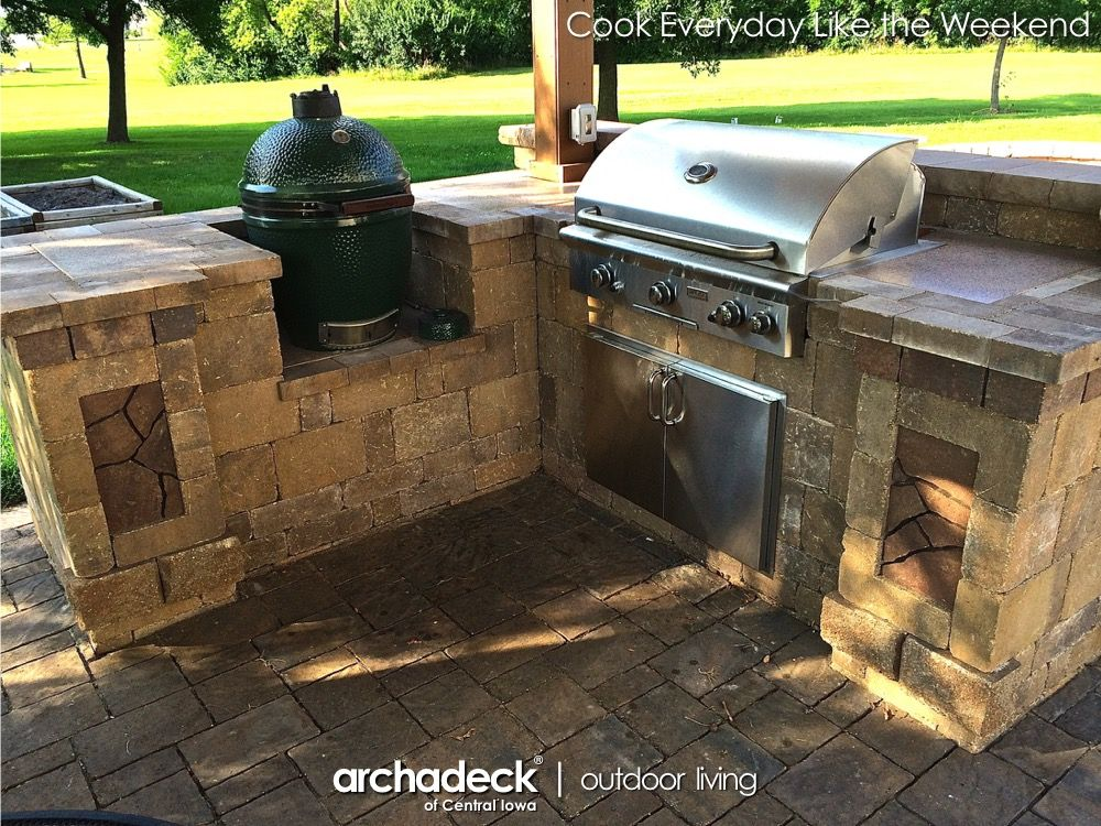 Grill and big green egg in this custom belgard outdoor for Outdoor grill kitchen design