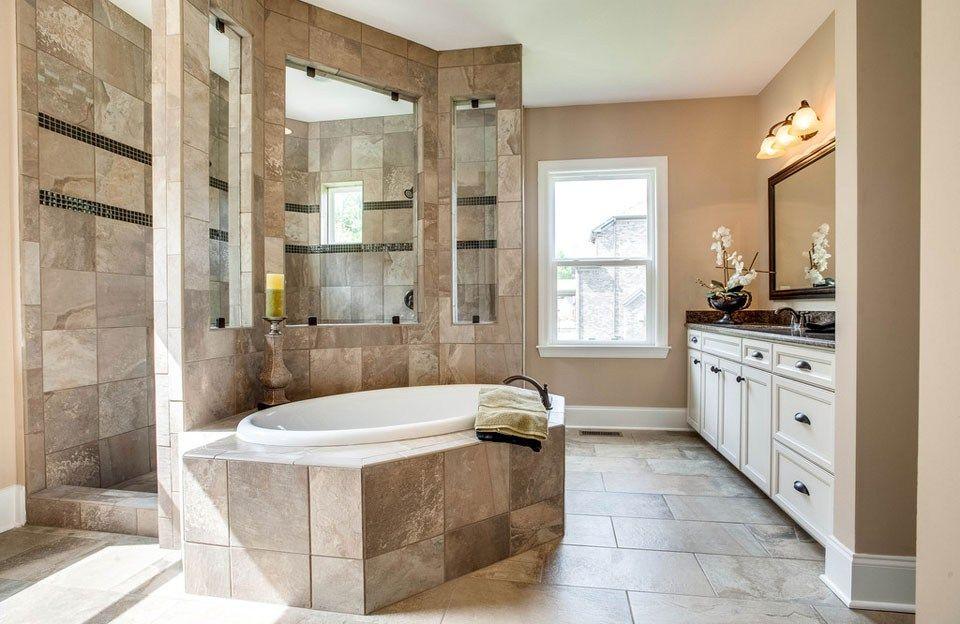 A spa-like walk-through shower overlooks a matching ...