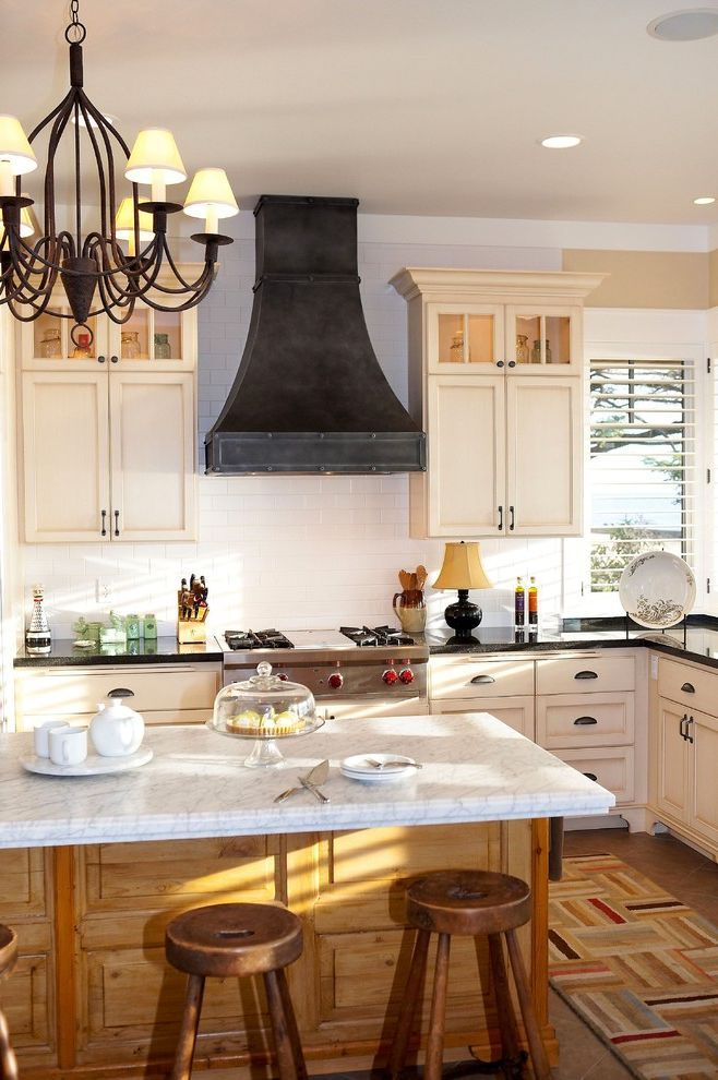 Ceiling mount vent hood with traditional kitchen also black countertop range chandelier cooktop glass cabinets island white cabi