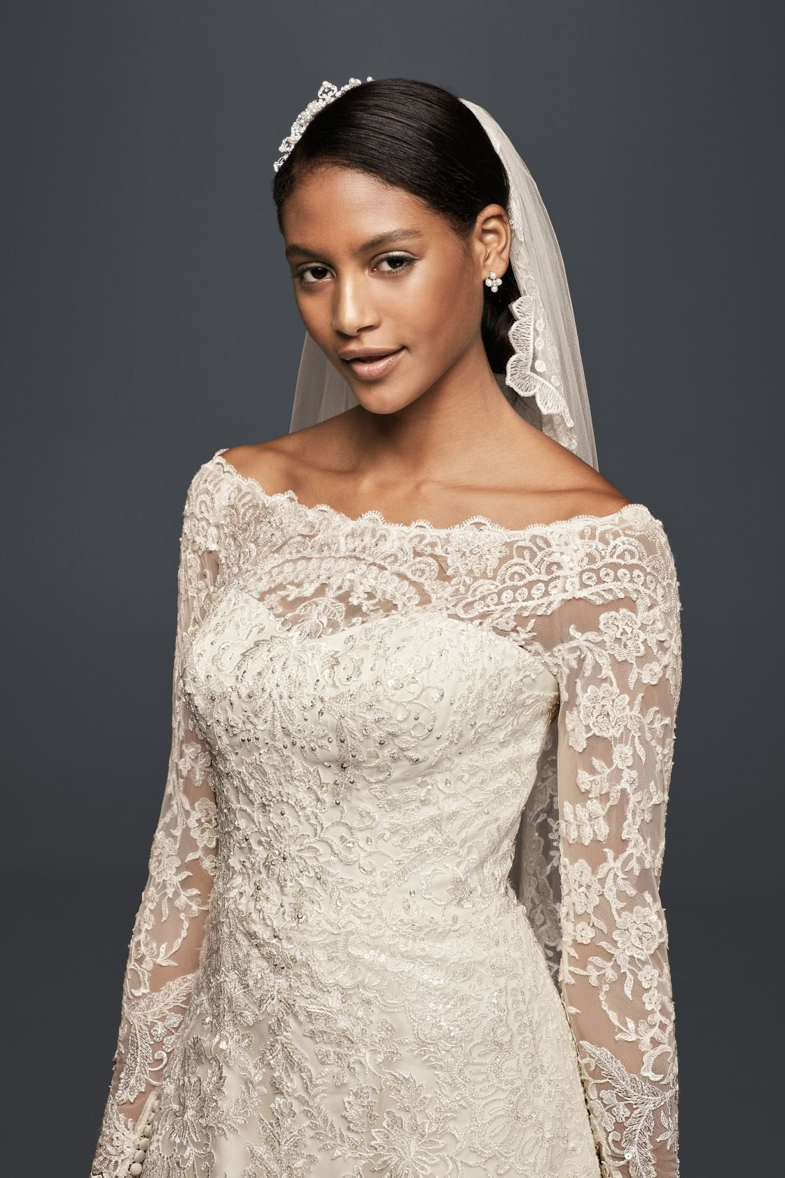 Opt for a sleek wedding day updo paired with a classic lace trim