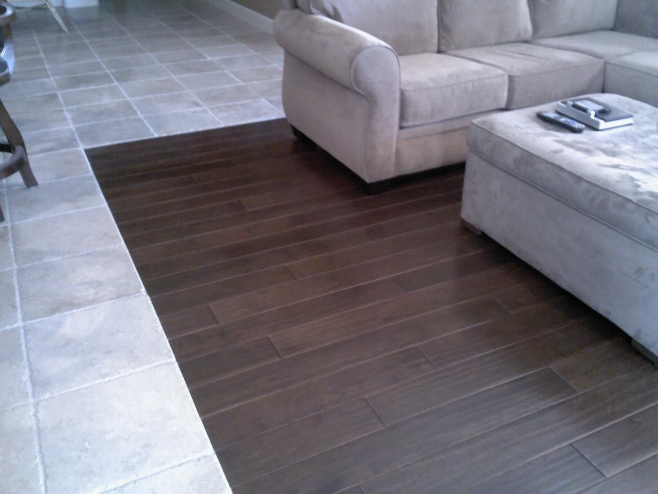 Wood Chevron Entryway Transitioning Into Tile Kitchen Floor