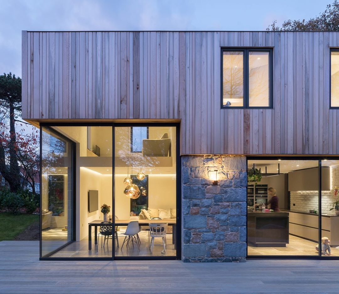 Timber Stone And Glass Work So Well On This Family Home Located In Guernsey The Energy Efficient And Sustainable Facade Design Architecture Modern House Design
