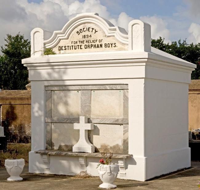 This tomb, for the Society for the Relief of Destitute Orphan Boys, is located in Lafayette Cemetery No. 1. The society was founded as a refuge for children who lost their parents to yellow fever and other epidemics, or otherwise lacked guardianship.  Today, it is known as the Waldo Burton Memorial Boys' Home; after 175 years, its mission is still to care for and educate boys in need.