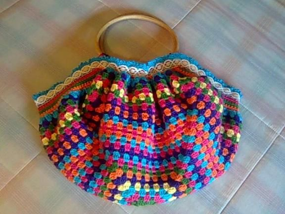 One big granny square. Good for those yarn leftovers.  Brilliant!