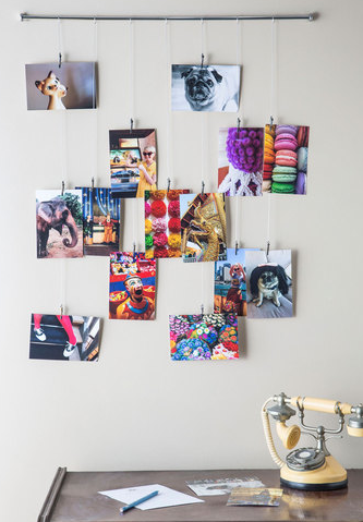 http://www.modcloth.com/shop/decorative-accessories/picture-frame-and-glory-photo-hanger