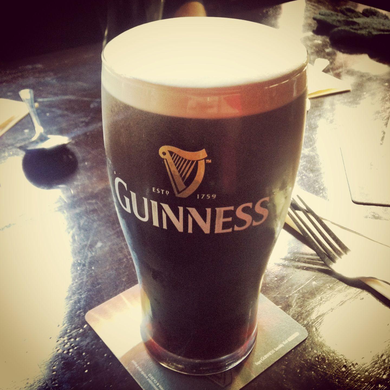 Pint of Guinness in an Irish pub, Ireland.