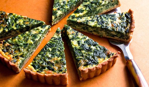 Spinach and onion tart with whole wheat and olive oil crust
