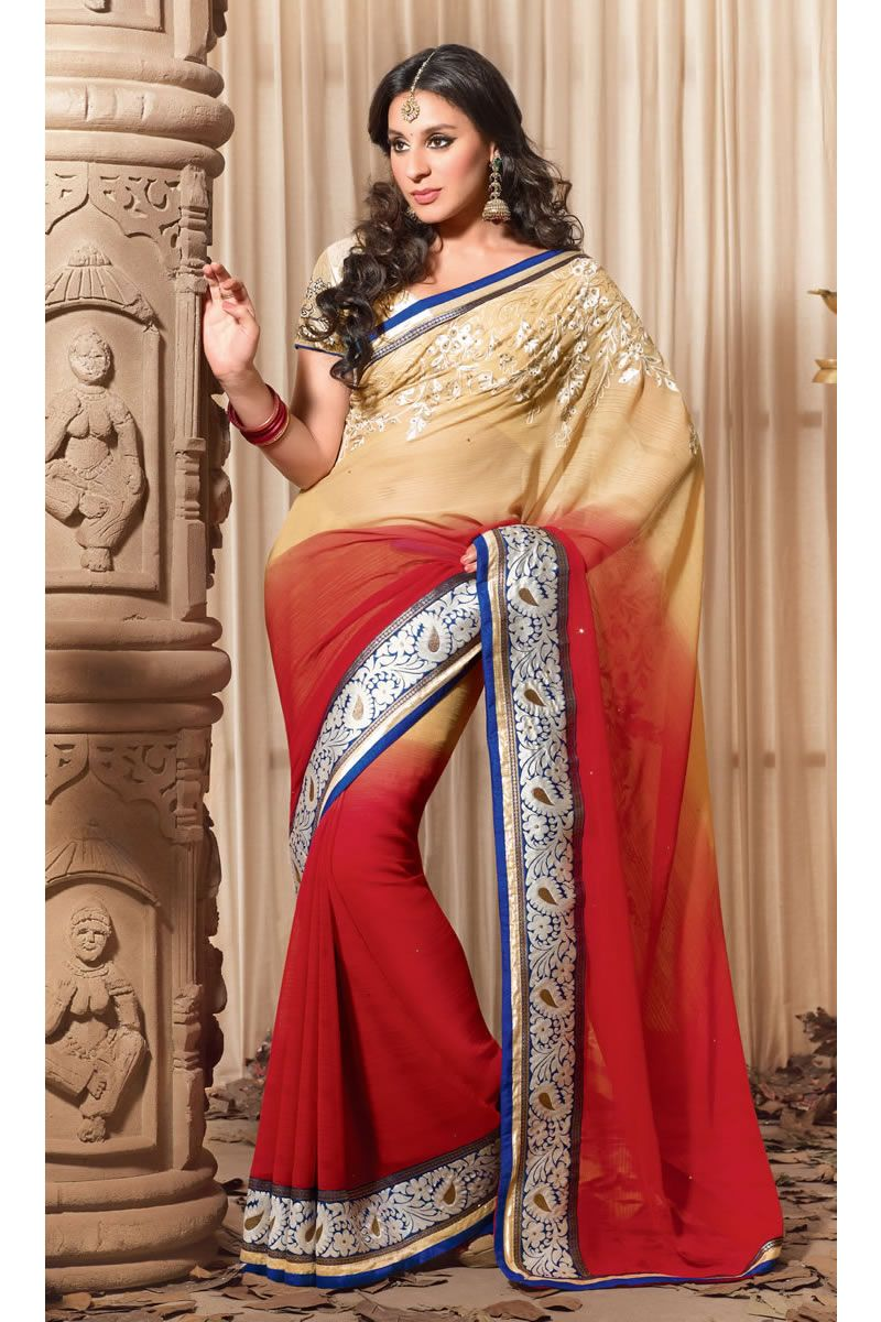 This yellow & red color designer party wear saree looks awesome and the main key feature of the saree is the lace on it and the blouse makes the saree more beautiful when you wear it.
