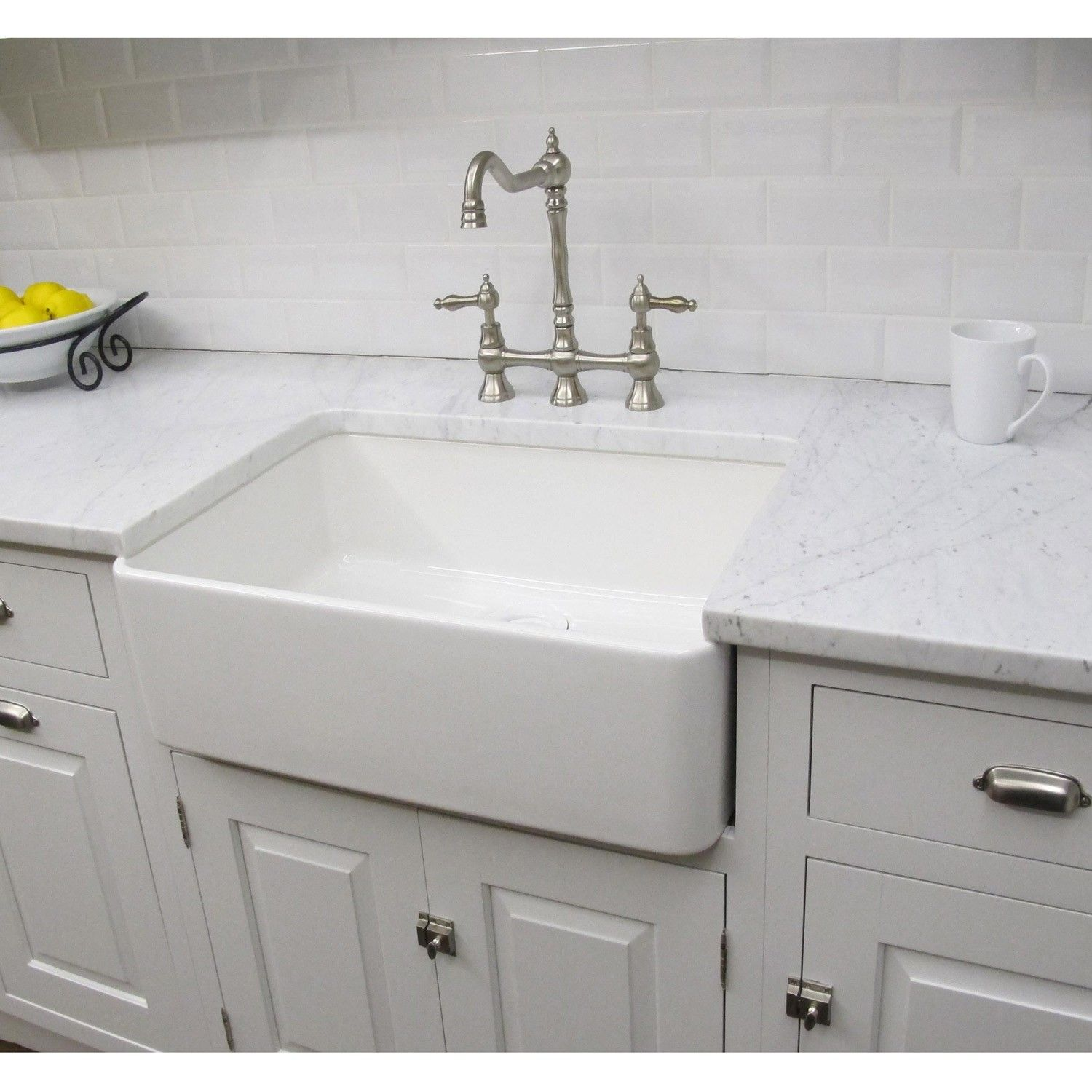Constructed of fireclay, this large bathroom sink has a classic ...