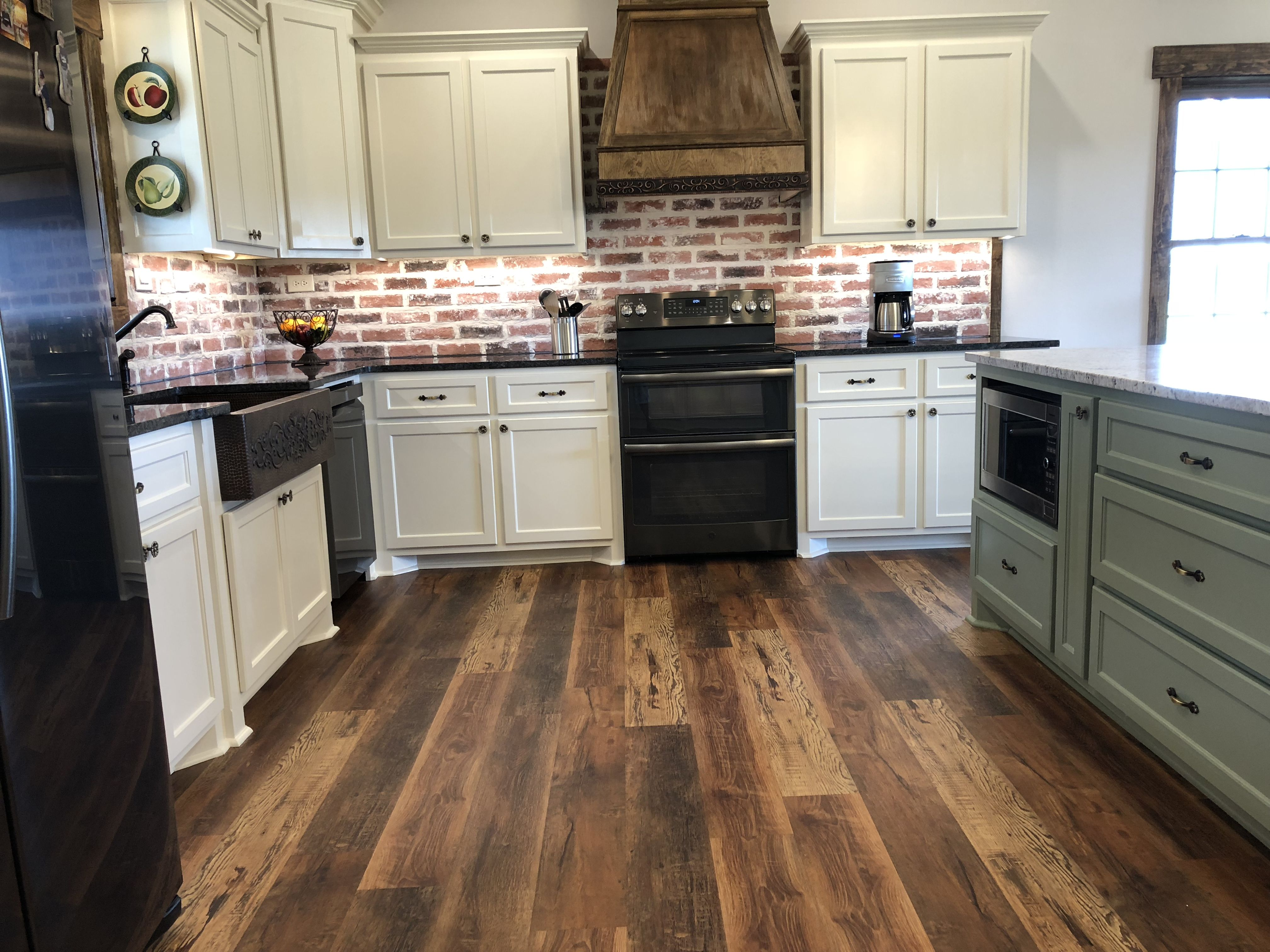 Black Granite Countertops Luxury Vinyl Rustic Wood Look Floors Brick Backsplash And Copper Sink Love Our Kitchen