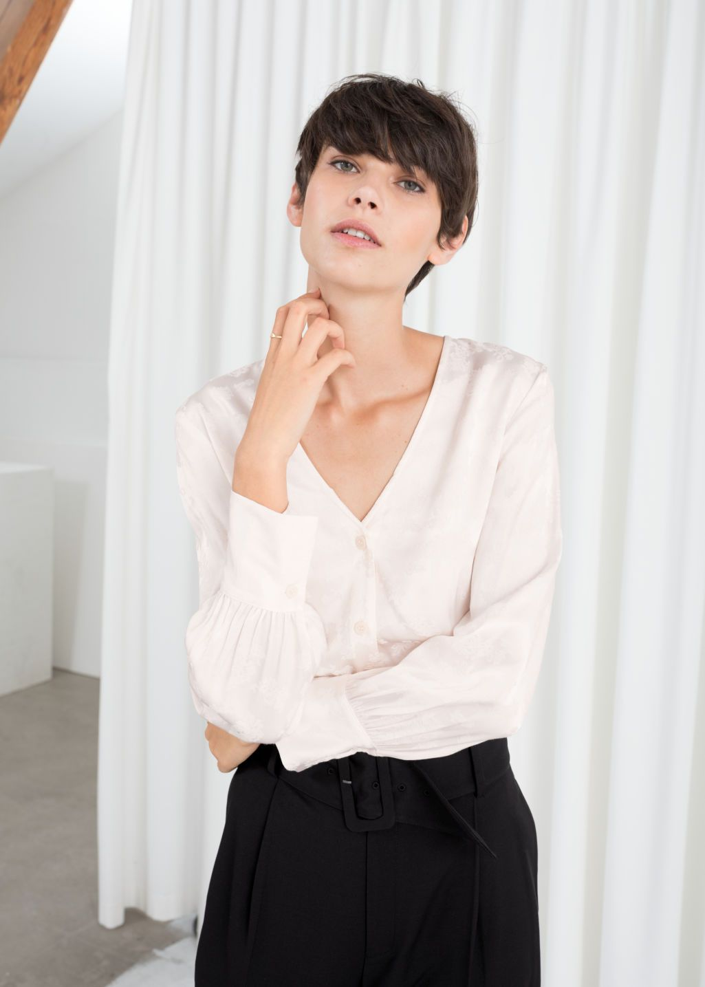 76955ebdcecb31 Model front image of Stories v-neck floral jacquard blouse in white