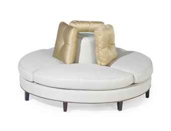 A Circular White Upholstered Confidante Sofa Couches For Sale Round Couch Round Sofa Chair