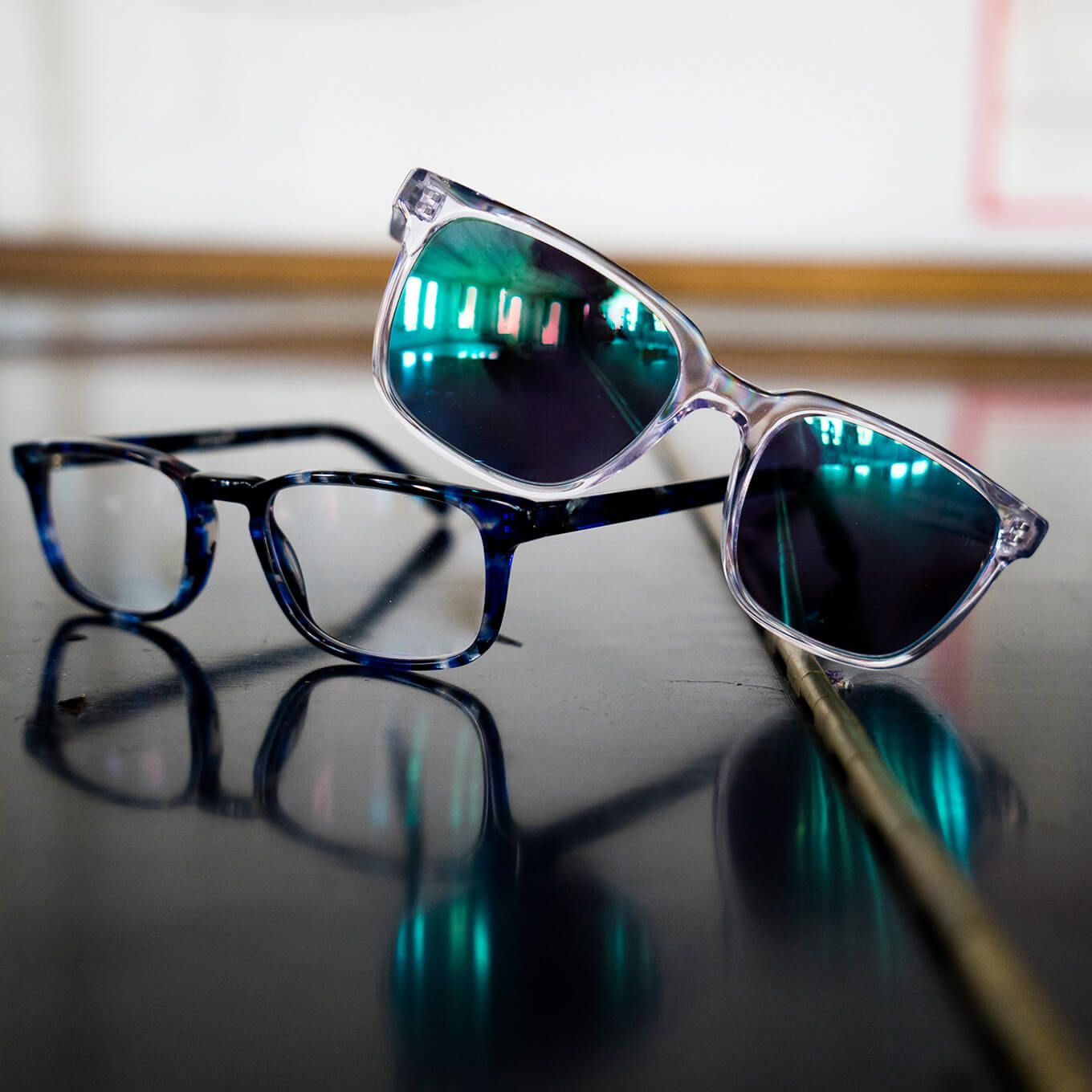 cfcca355d1 Translucent Van Alen sunglasses with green mirror tint and blue  tortoiseshell Eames rectangle eyeglasses from the Zenni Metropolitan  Collection are pictured ...
