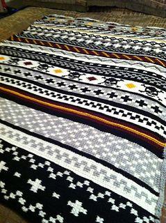 Fun crochet skull afaghan. Free pattern on ravelry.