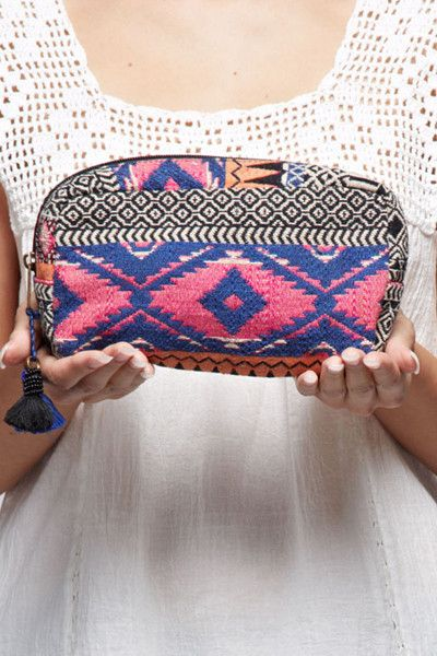 2a510290d2c4 Fit everything you might need in this pretty tapestry makeup bag. The  oblong size and contrasting tassel time and zip closure really give this bag  a ...