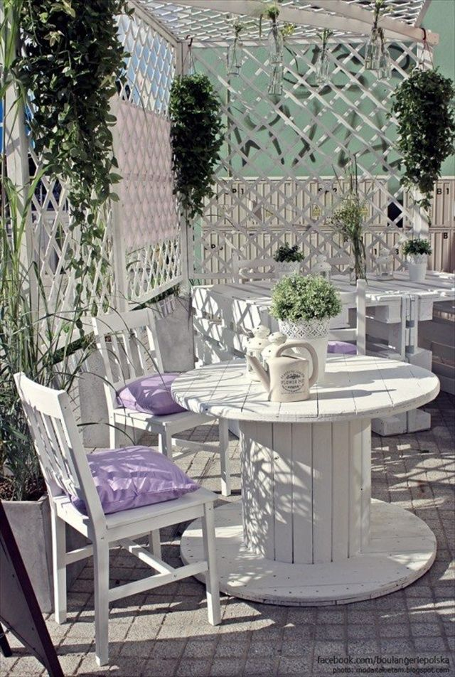 cafe garden made of recycled pallets spools crates pallet ideas - Garden Furniture Crates