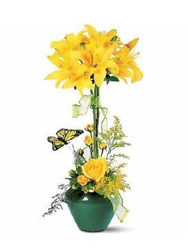 Lily Topiary — Lilies seemingly burst out of the ground while a butterfly flutters close by. It's an arrangement that's just right for any occasion. #easter #springflowers #theflowerlady #milwaukeeflorist