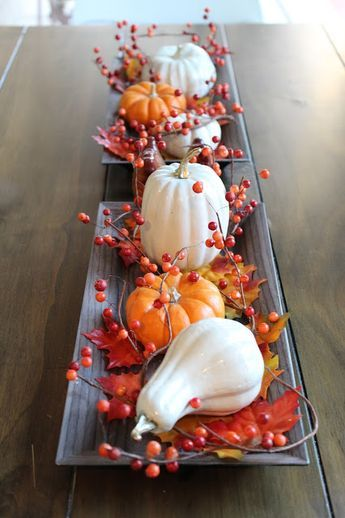 Simple fall table centerpiece decoration! Using inexpensive candle trays from Michaels, leaves, and a simple fall DIY! Create faux ceramic pumpkins and gourds using Dollar Tree foam veggies! #herbstdekotischtablett