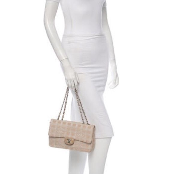 9795f3464983 Authentic Chanel Bag Gold and creme Chanel Travel Line Flap bag with quilted  stitching throughout,