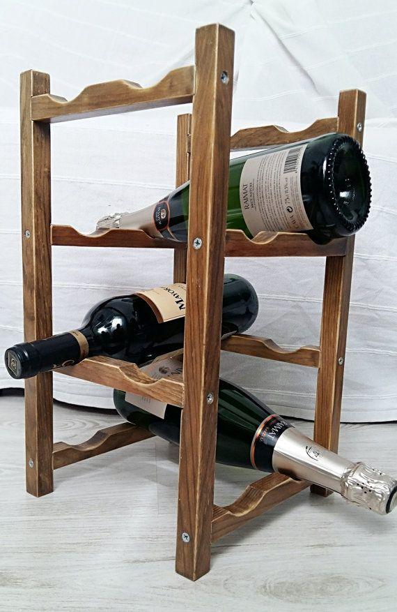 Mira este artículo en mi tienda de Etsy: https://www.etsy.com/es/listing/452340826/wooden-wine-rack-square-bottle-bottle