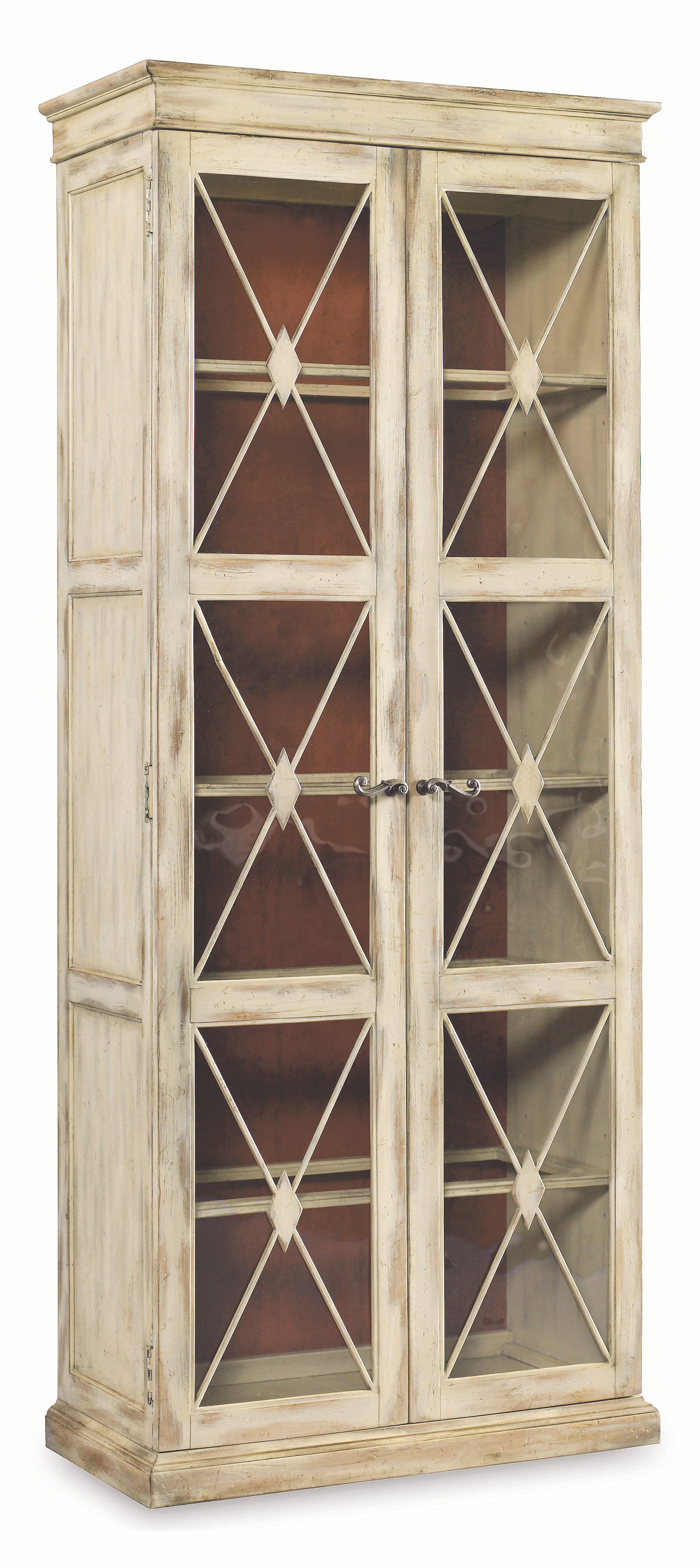 This two-door display cabinet, crafted of hardwood solids and oak veneers, offers a French country feel in any space.