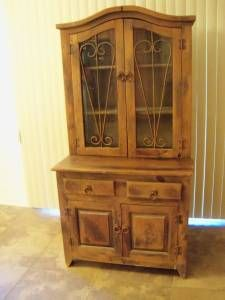 Tall Hutch Top Half Has Shelves For Display With Gl Windows And Wrought Iron Designs All Metal Fixtures Have Been Treated Acid To Give A Rusty