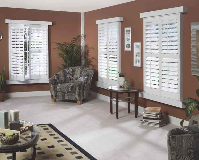 pictures of outside mounted woodand or faux wood shutters and