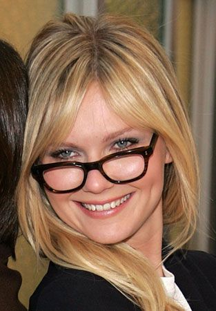 37b97e6094c Kirsten Dunst rocks a chunky frame in a classic color - perfect for a round  face. Get the look with eyebobs Fizz Ed.