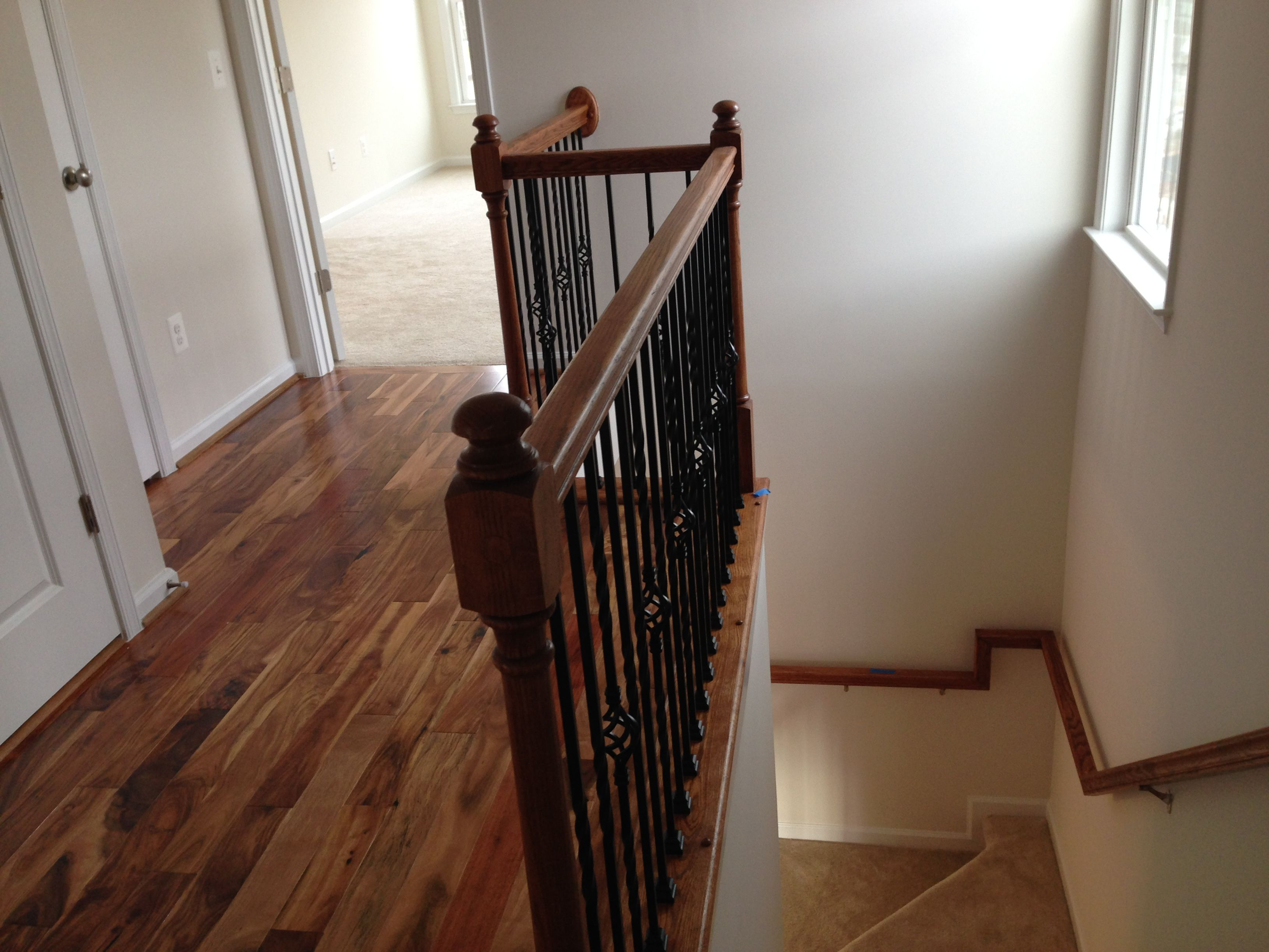 Fully Carpeted Staircase With Upgraded Iron Spindles