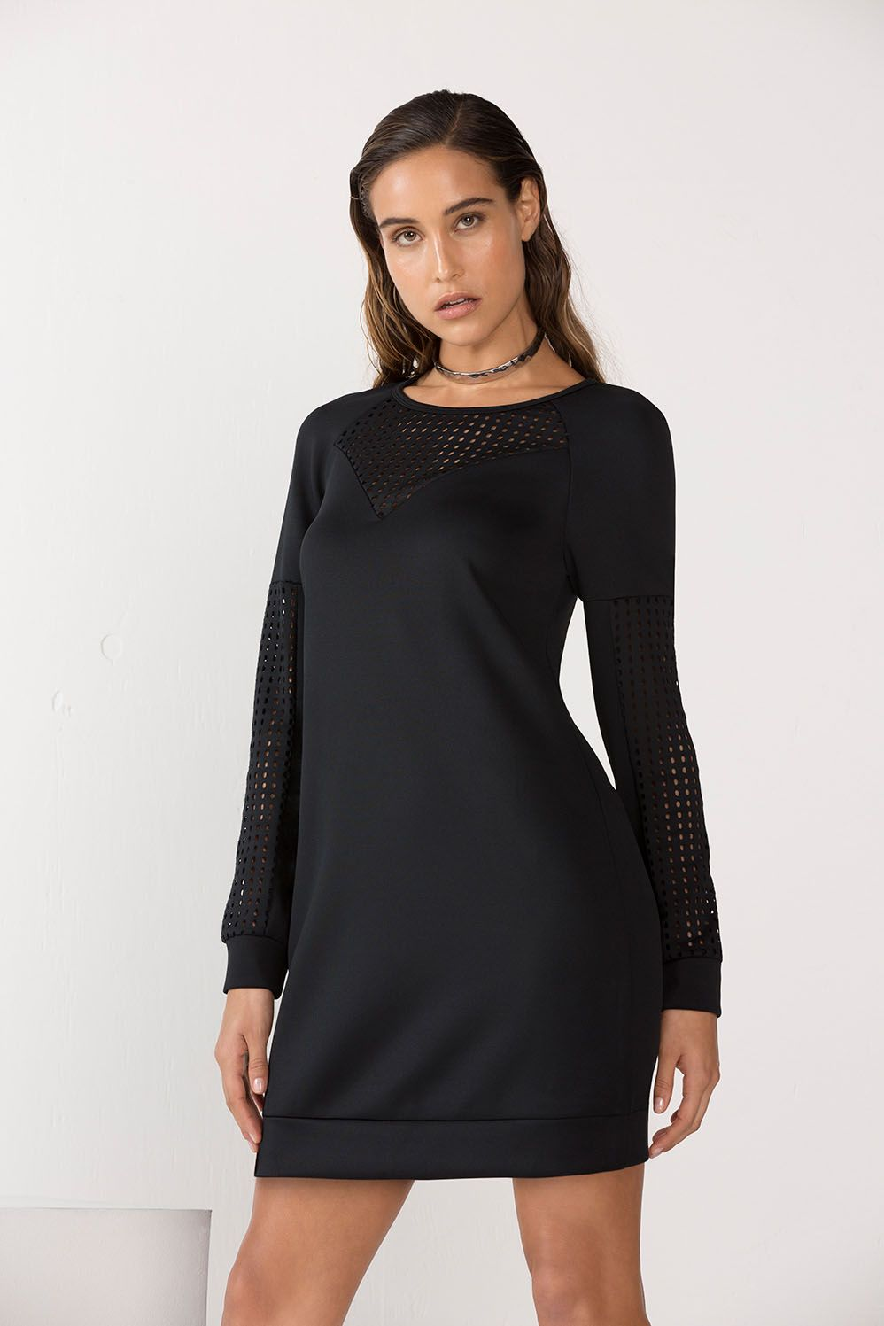 Just as the weather is getting cooler, your dresses are too. Get in some extra airflow in our perforated-paneled mini dress crafted from a much-loved, stretch neoprene fabric which keeps it shape after wear.