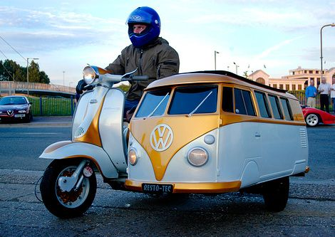 Vespa with a VW bus side car.