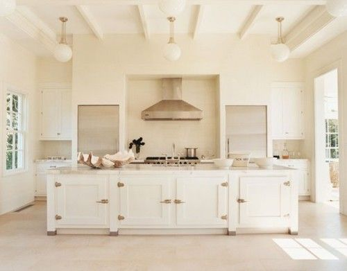 Fun with cabinet hardware and pendant light fixtures with globe shades. Stunning!