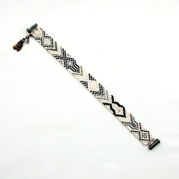 Caleidoscopische wit en zwart mager Bead Loom armband