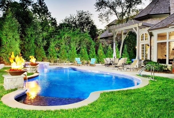 Pools Fascinating Modern Pool Landscaping Ideas With Artistic Pool Waterfall And Circular Jacuzzi Warm Torches Stylish Chaise Lounge Chairs Artistic Pool Lan
