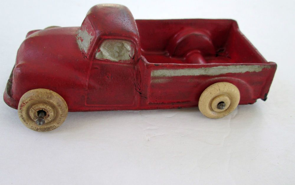 Vintage 1940s Arcor Toy Rubber Pick Up Truck in Red with White Wheels. Who's old enough to have played with this one?